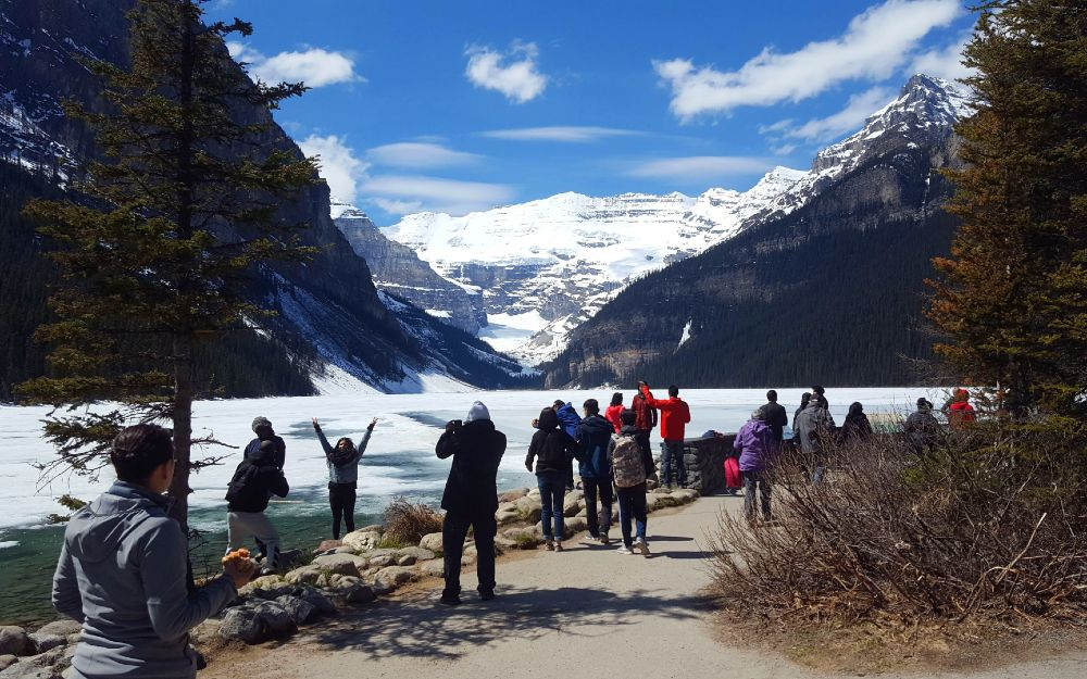 Lake Louise in Spring, covered in slushy snow/ice.