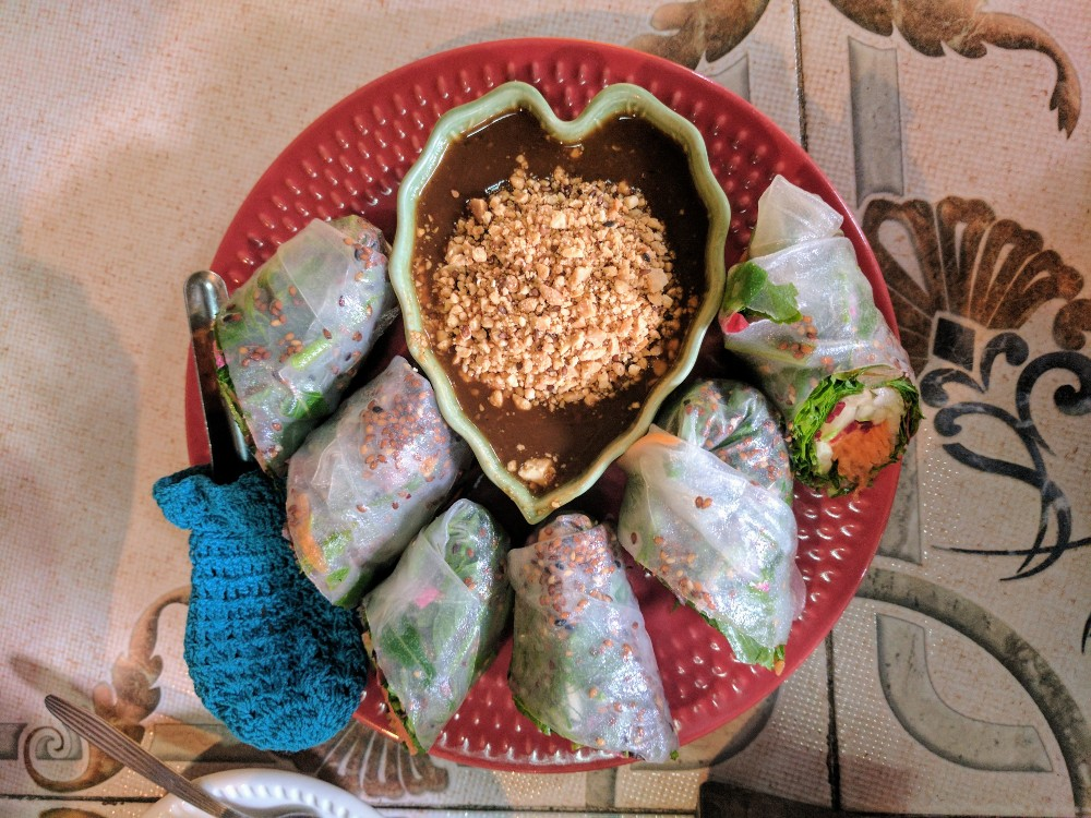 It's still possible to be radiantly healthy and eat good vegan food while traveling—like these vegan rice wraps from Pai, Thailand.