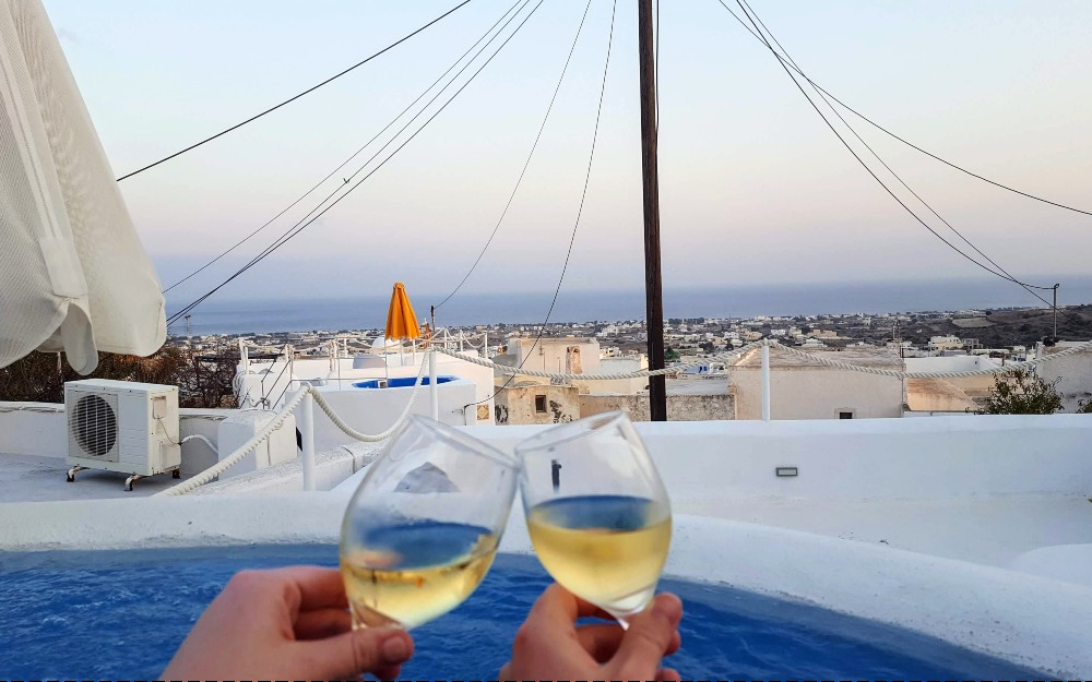 Chilling with some Assyrtiko wine in our rooftop hot tub.