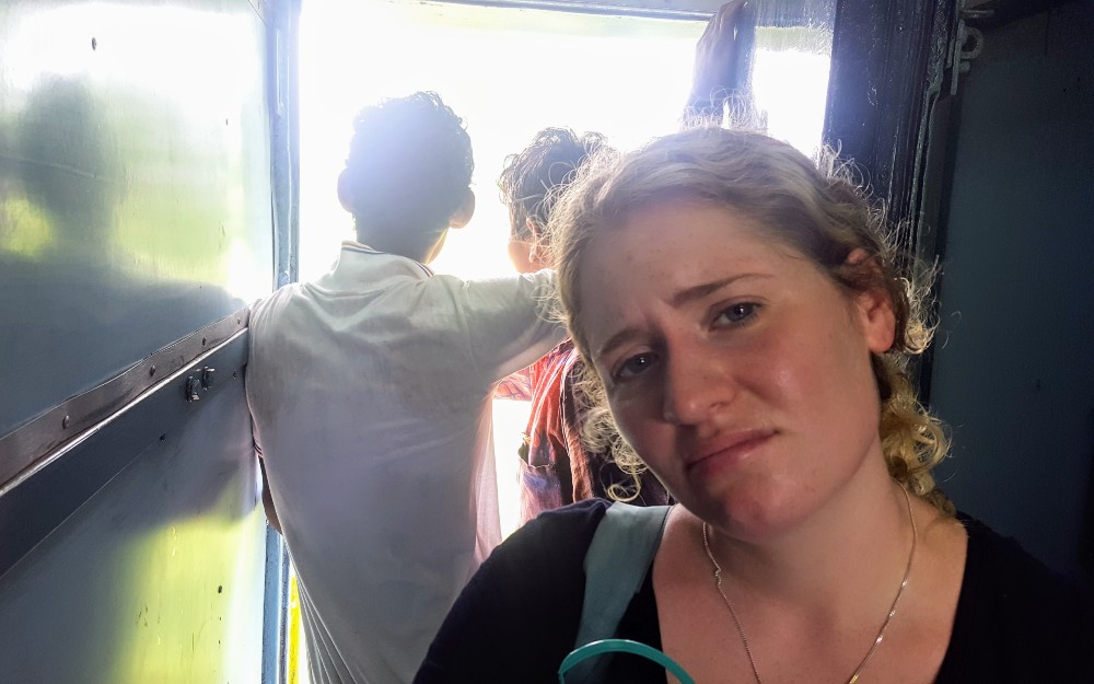Having a bit of a day on a train in India. This photo was right after noticing that water from the train's bathroom was leaking out onto the floor and soaking onto our bags...