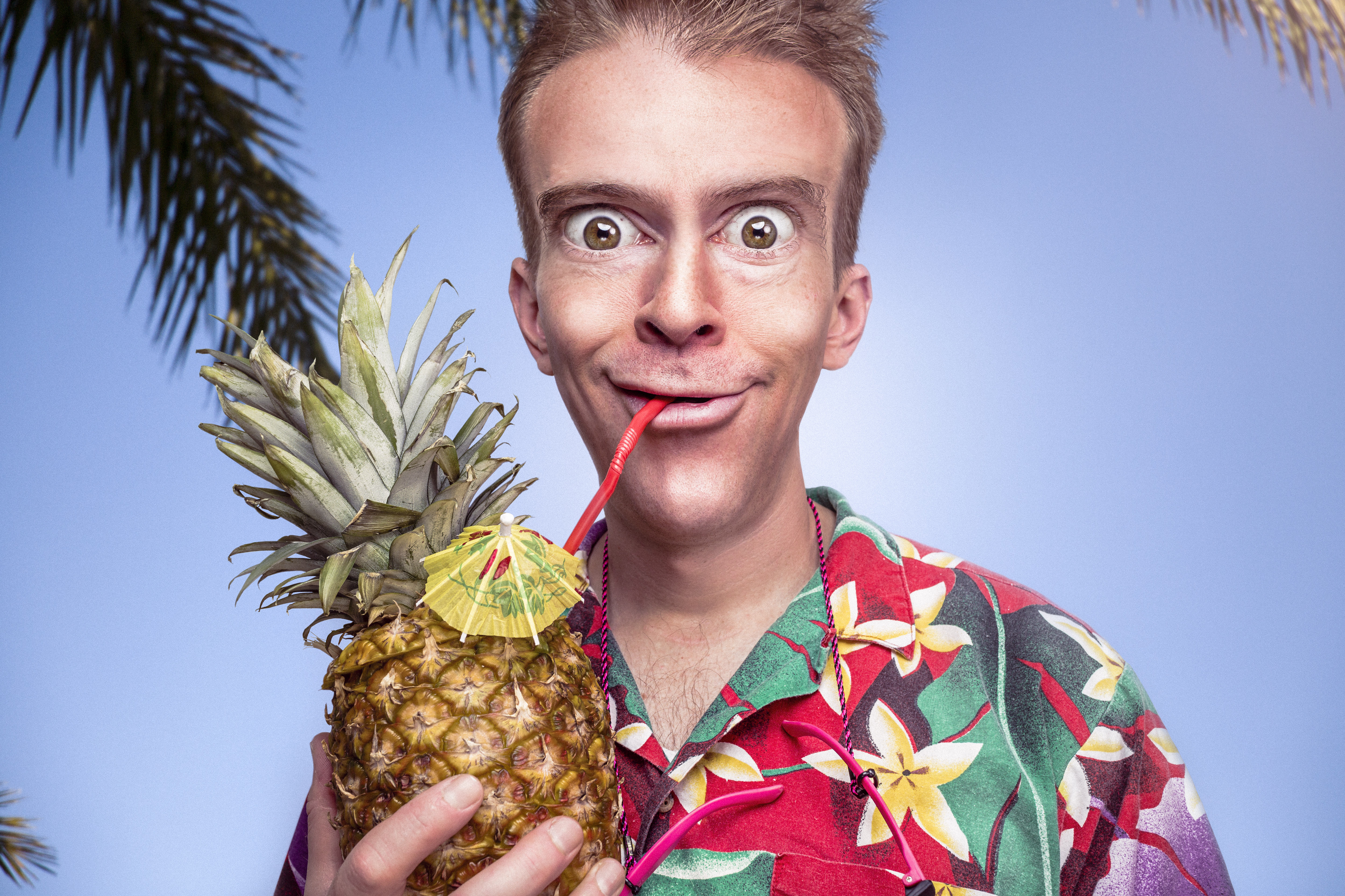 odd man drinking from a pineapple