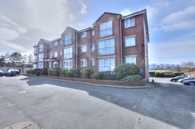 Upper ground floor flat, purpose built development, unfurnished, gated parking, 2 bedrooms, open plan kitchen/lounge.