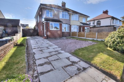 Semi detached extended house for sale on Edge Lane, Thornton, well presented, close to shops & schools, South facing rear garden, driveway, garage.