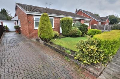 Lupton Drive, Crosby, semi detached bungalow, quiet location, mature rear garden, long driveway, garage, conservatory, 2 double bedrooms.