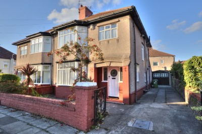 Duddingston Avenue, Crosby, spacious semi detached family house, close to shops, parks and schools, 3 bedrooms, long driveway, garage, pleasant gardens.