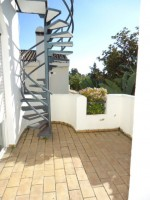 spiral stair case leading to roof terrace off mater bedroom