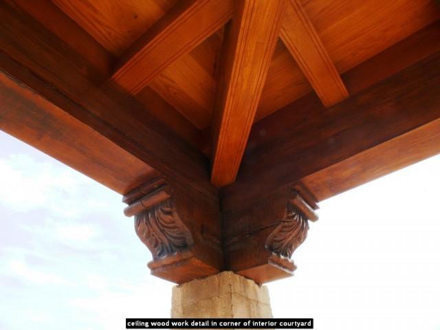 ceiling wood work detail in corner of interior courtyard