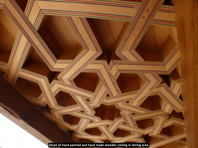 detail of hand painted and hand made wooden ceiling in dining area
