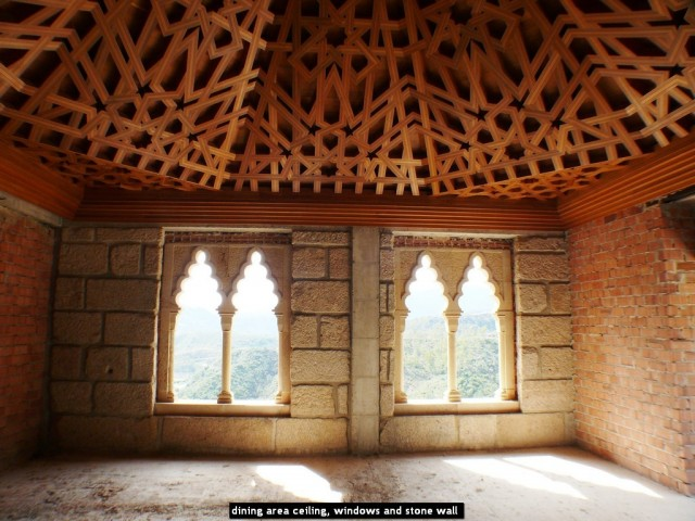 dining area ceiling, windows and stone wall