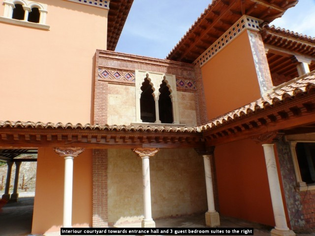 interiour courtyard towards entrance hall and 3 guest bedroom suites to the right