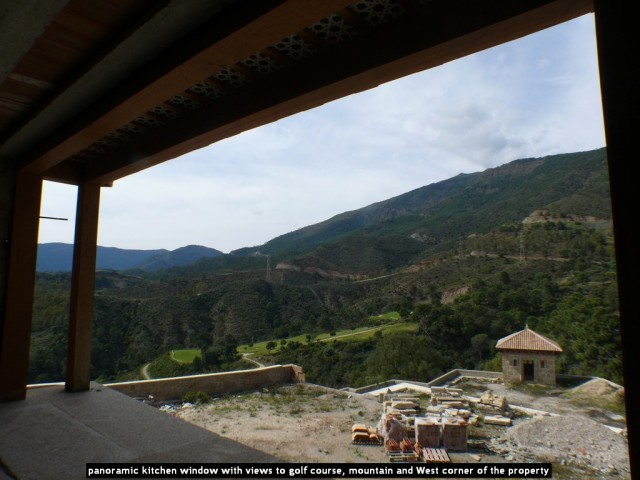 panoramic kitchen window with views to golf course, mountain and West corner of the property