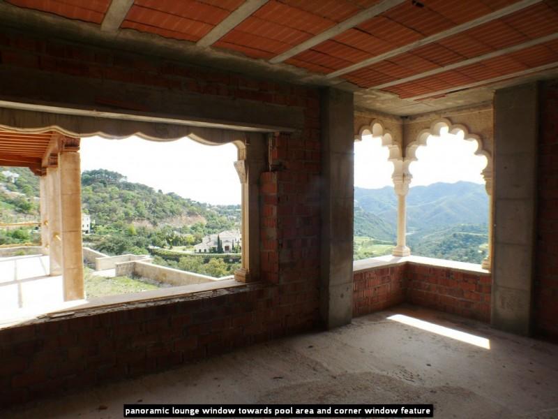 panoramic lounge window towards pool area and corner window feature
