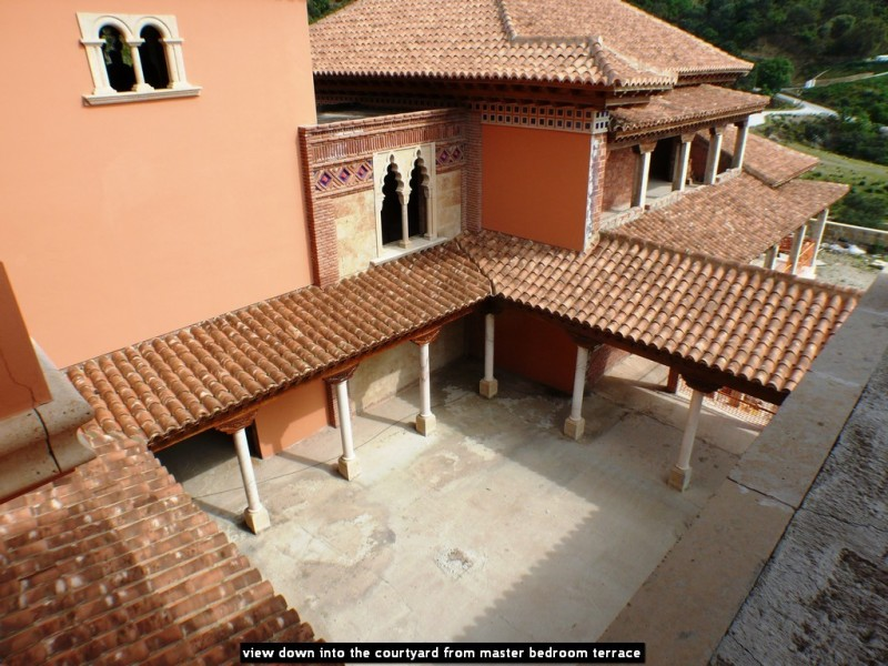 view down into the courtyard from master bedroom terrace