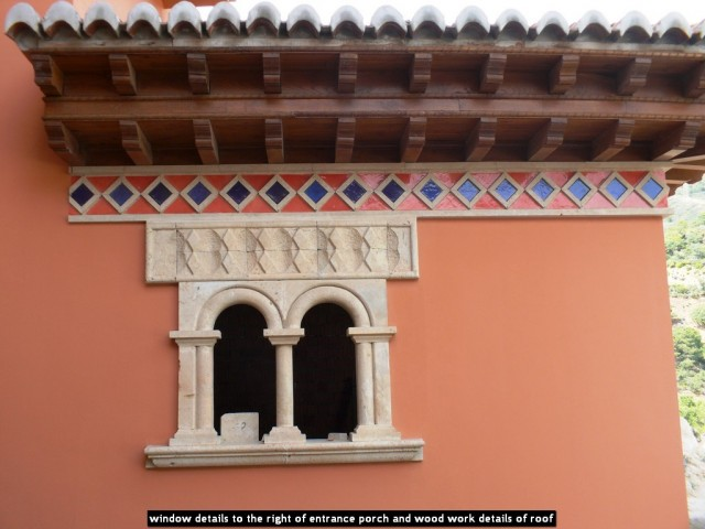 window details to the right of entrance porch and wood work details of roof