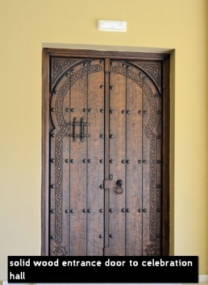 solid wood entrance door to celebration hall