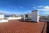 Large penthouse apartment in needed of renovation situated just a few minutes walk to the beach and most of the amenities of Puerto de Pollensa
