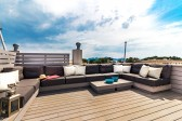 Stylish penthouse apartment with private roof terrace located just a few meters from the beach of Puerto de Pollensa.