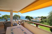 Top floor apartment for sale situated right on the sea front in Puerto de Pollensa. Large balcony and communal pool.