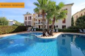 Immaculate 3 bedroom apartment with communal swimming pool just  steps from the beach
