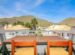 Immaculate 3 bedroom penthouse apartment with communal swimming pool in quiet part of town
