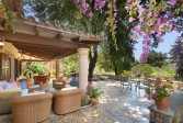 """Enchanting villa nestled on a large plot of 5.473 sq.m. with lush gardens and mature pine trees, in the residential area called """"La Font"""" in Pollensa"""