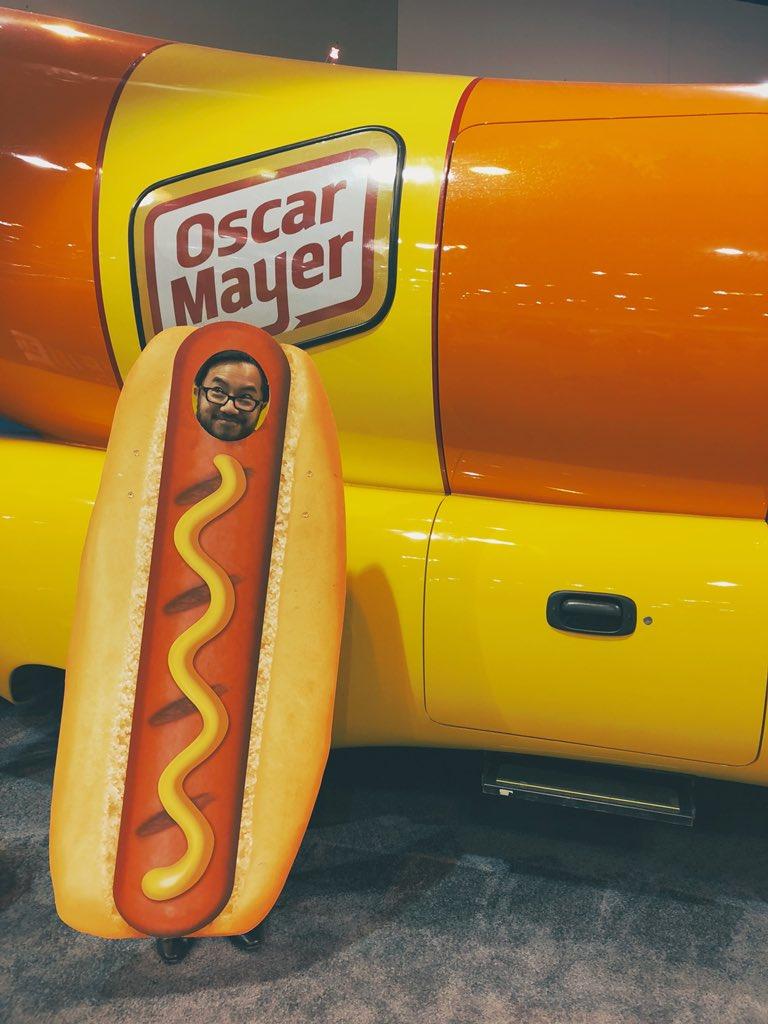 Garry behind hot dog cutout