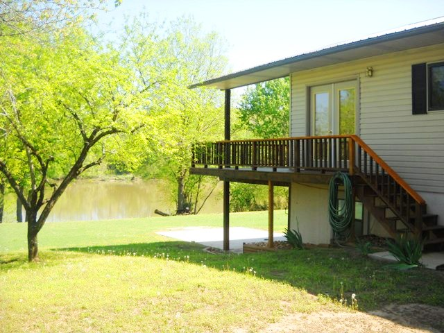 Your own get-away on the mighty White River. Nice flat lot sloping gently to the water. Wrap-Around Deck, Garage, Well, CH/CA heat pump, Lowmaintenance exterior, Oak Cabinets, Cathedral Ceiling & New Metal Roof in 2003. New well Dec 10. Has 130 ft River Frontage. REDUCED $10,000 TO$164,900.