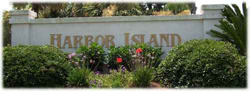 Image of the Harbor Island sign at turoff to Harbor Island Drive.