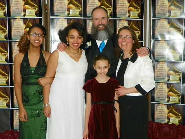 Pictured Kent at event in his honor on Jan. 15, also pictured are three of his daughters and his wife.