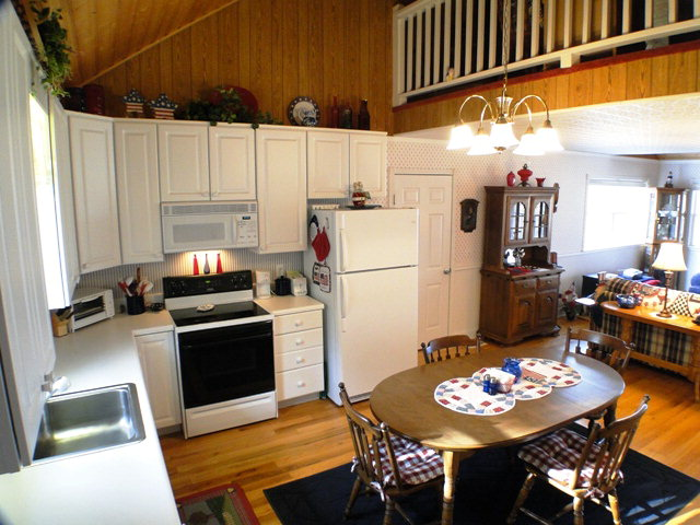 Bright and open kitchen with a cool loft above!  Keller Williams, Real Estate, Franklin NC