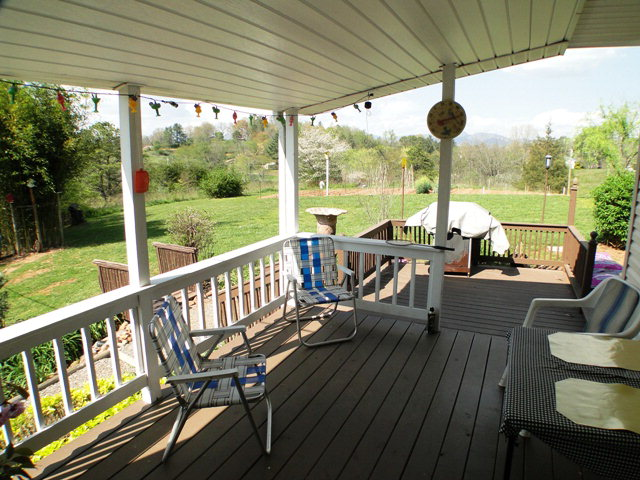 What a sweet view from the covered deck... or barbeque on the uncovered deck!  Keller Williams, Free MLS Search