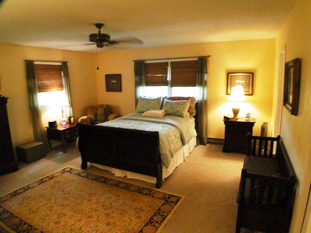 The spacious master bedroom has a private bath, John Becker, Bald Head the Realtor, Keller Williams