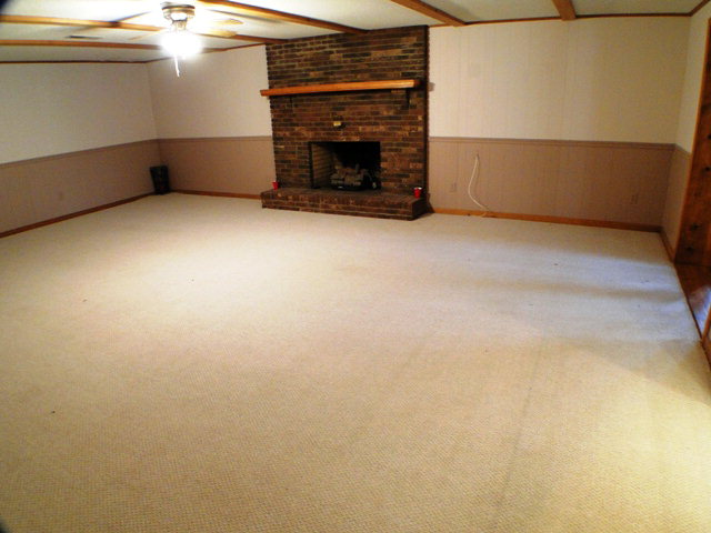 Lower level family room is HUGE with a brick fireplace, John Becker, Bald Head
