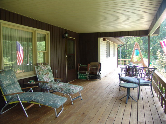 A lovely wrap-around porch for your enjoyment in any weather - it's covered!  Bald Head the Realtor