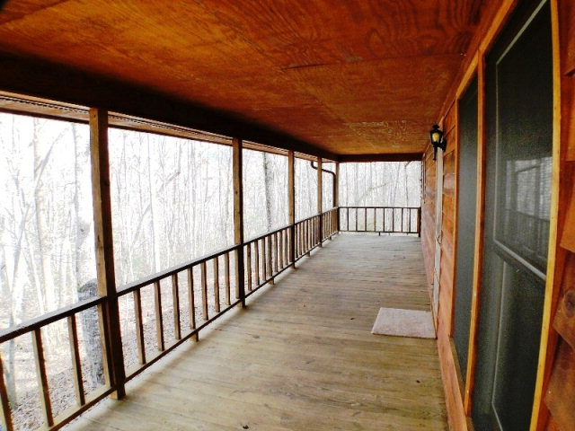Sit on your full length covered deck and enjoy the seasons!  John Becker BaldHead Franklin NC Keller Williams