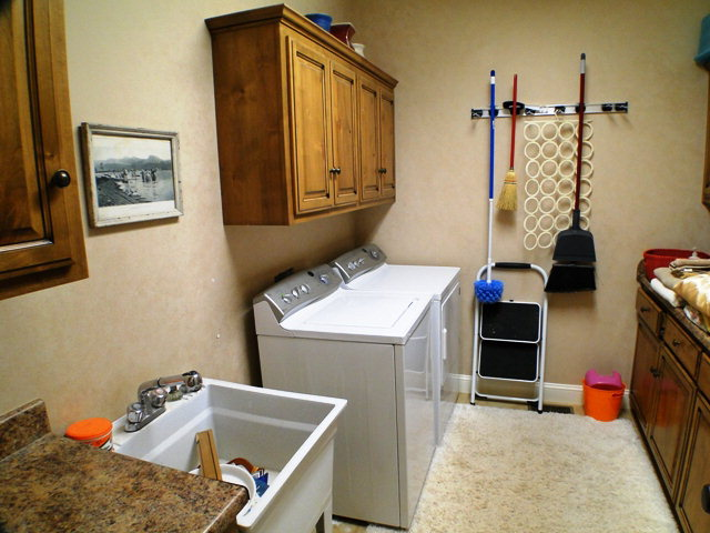 What a laundry room!  Granite counters, tile flooring and a sink!  Smoky Mountain Property