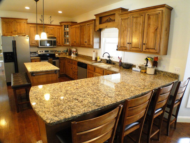 Spacious kitchen with granite countertops and an adjoining formal dining room, Keller Williams, Franklin NC