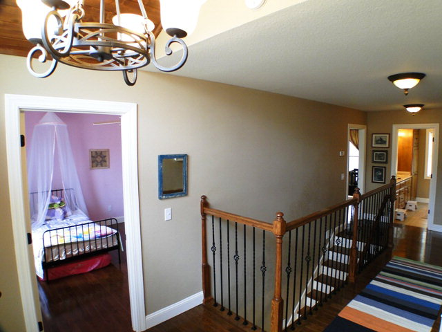 Beautiful staircase and landing area for the three upstairs bedrooms, John Becker, Smokey Mountain Properties