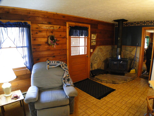 Get cozy by the wood stove!  Smokey Mountain Blue Ridge Cabin for Sale