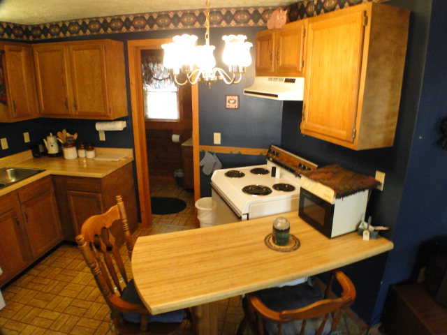There is a greatroom with kitchen, bedroom and bath on each side of the cabin, Franklin Otto NC Cabin for Sale