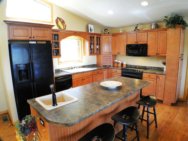 Open gourmet kitchen with pantry and two sinks, John Becker, NC Real Estate