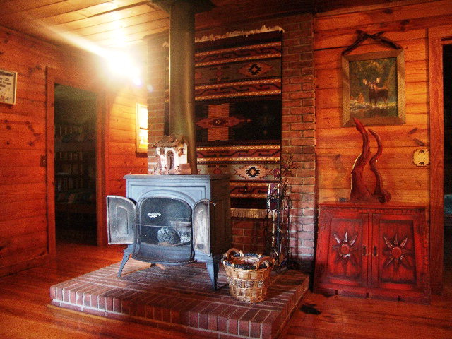 The log home is equipped with a Vermont Castings wood stove in addition to the Central Heat and Air, Otto NC Log Home for Sale