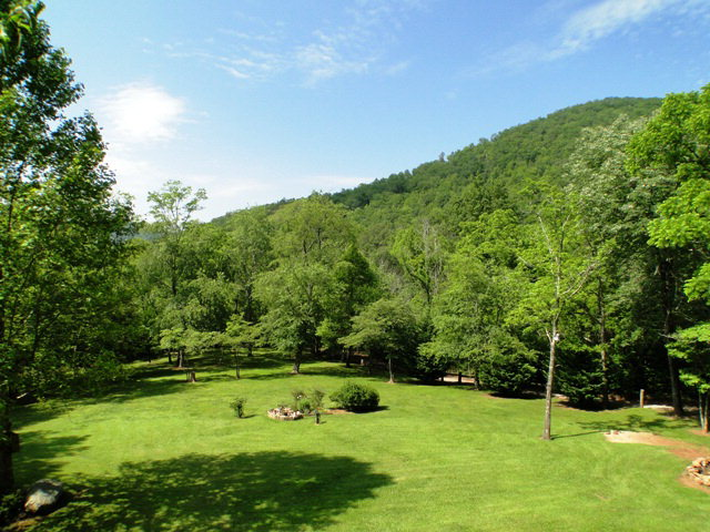 Take in the beautiful view of mountains and rolling pasture from the large deck, Franklin NC Log Cabin, Franklin NC Realty