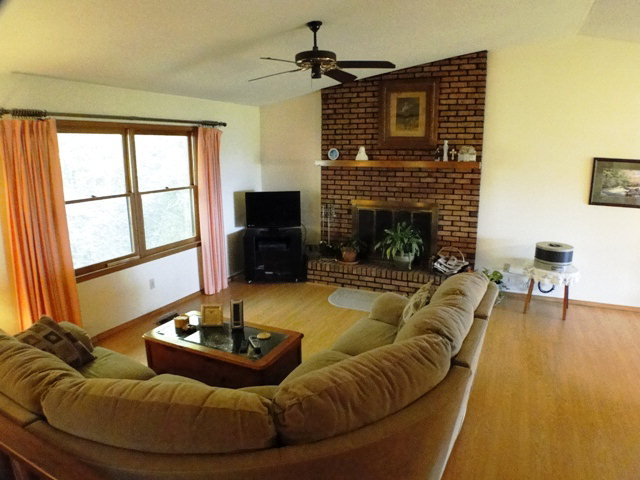 Vaulted ceiling and brick fireplace in the living room, 840 Dellwood Road Franklin NC, Bald Head John Becker