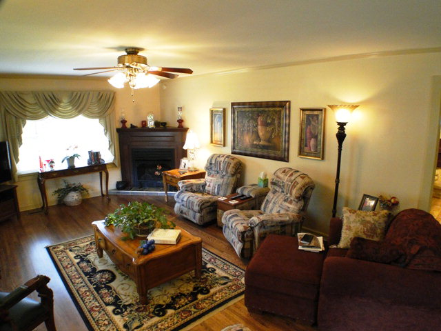 Nice and bright living room with hardwood floors and gas log fireplace, Keller Williams Real Estate