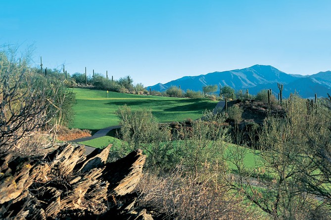 Active Adult 55 Golf Course in lush Sonoran desert with mountain view
