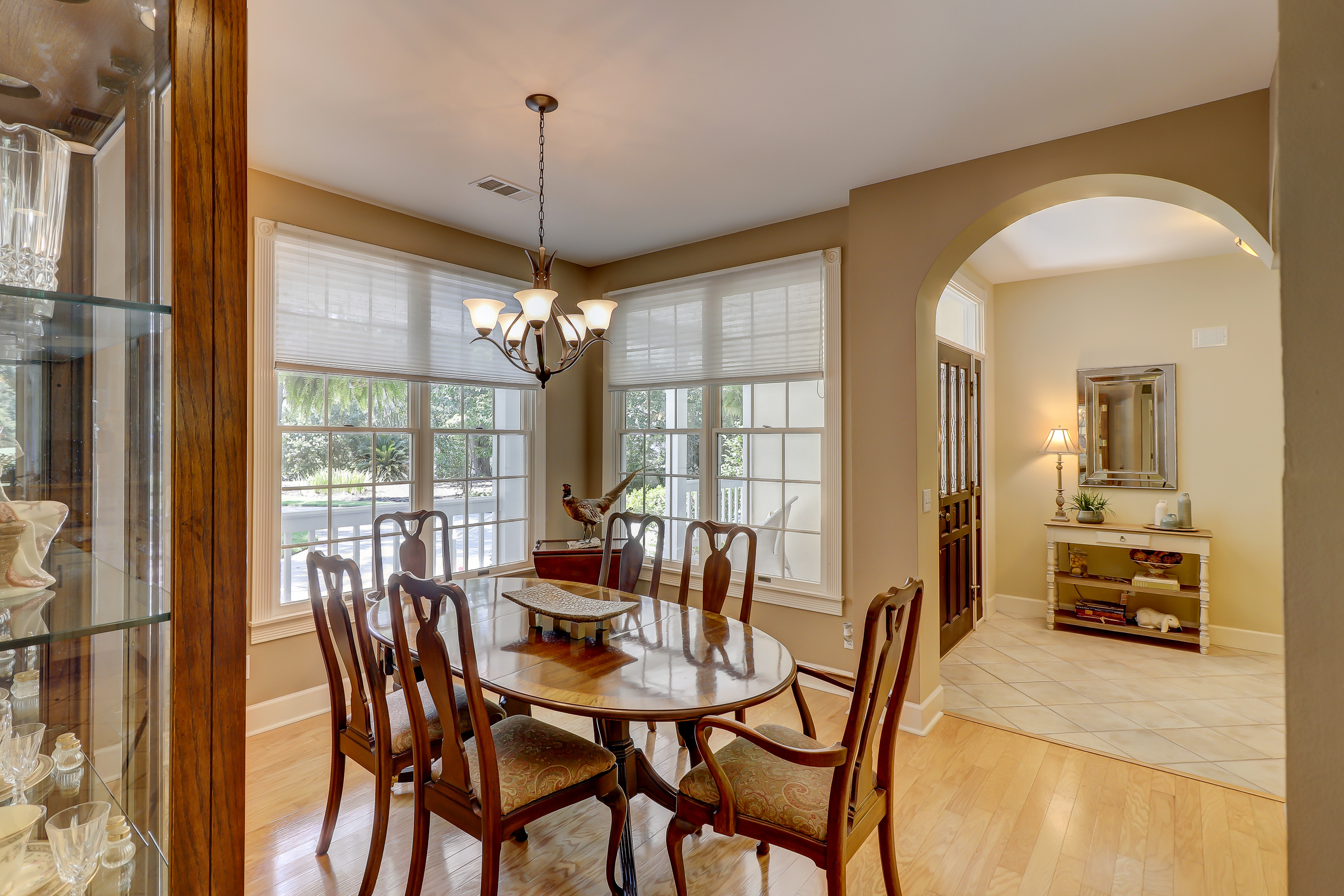 The formal dining room is off of the foyer and offers plenty of natural light with four windows which shines off of the hardwood floors.  The arched openings and great view of the beautiful front yard make this a special place to gather. 314 Fort Howell Dr - Palmetto Hall -  Hilton Head