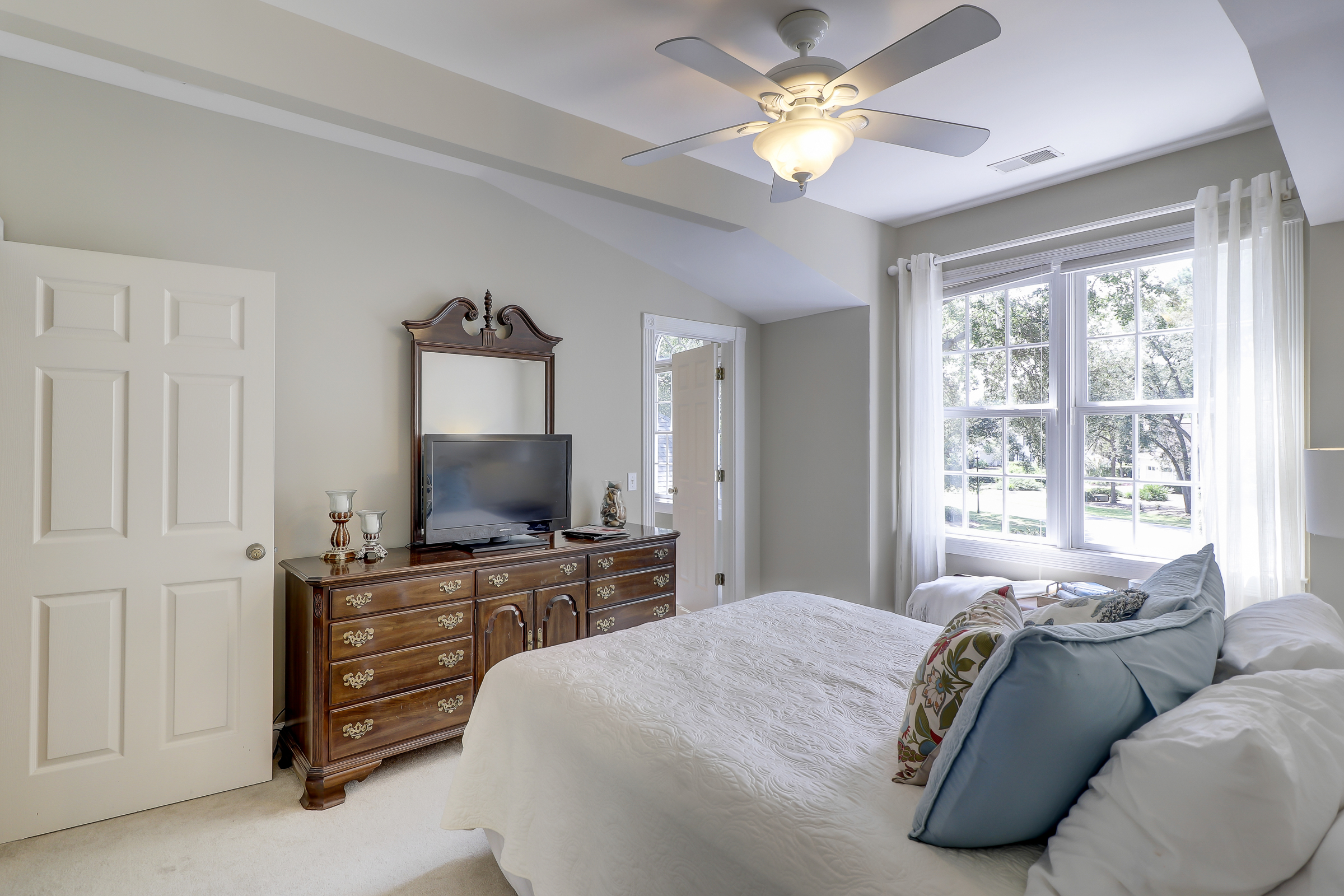 The upstairs bedrooms are very spacious and private. This bedroom offers a large walk in closet. The corner door enters a Jack and Jill Bath and the dormer windows overlook the front yard. 314 Fort Howell Dr - Palmetto Hall -  Hilton Head