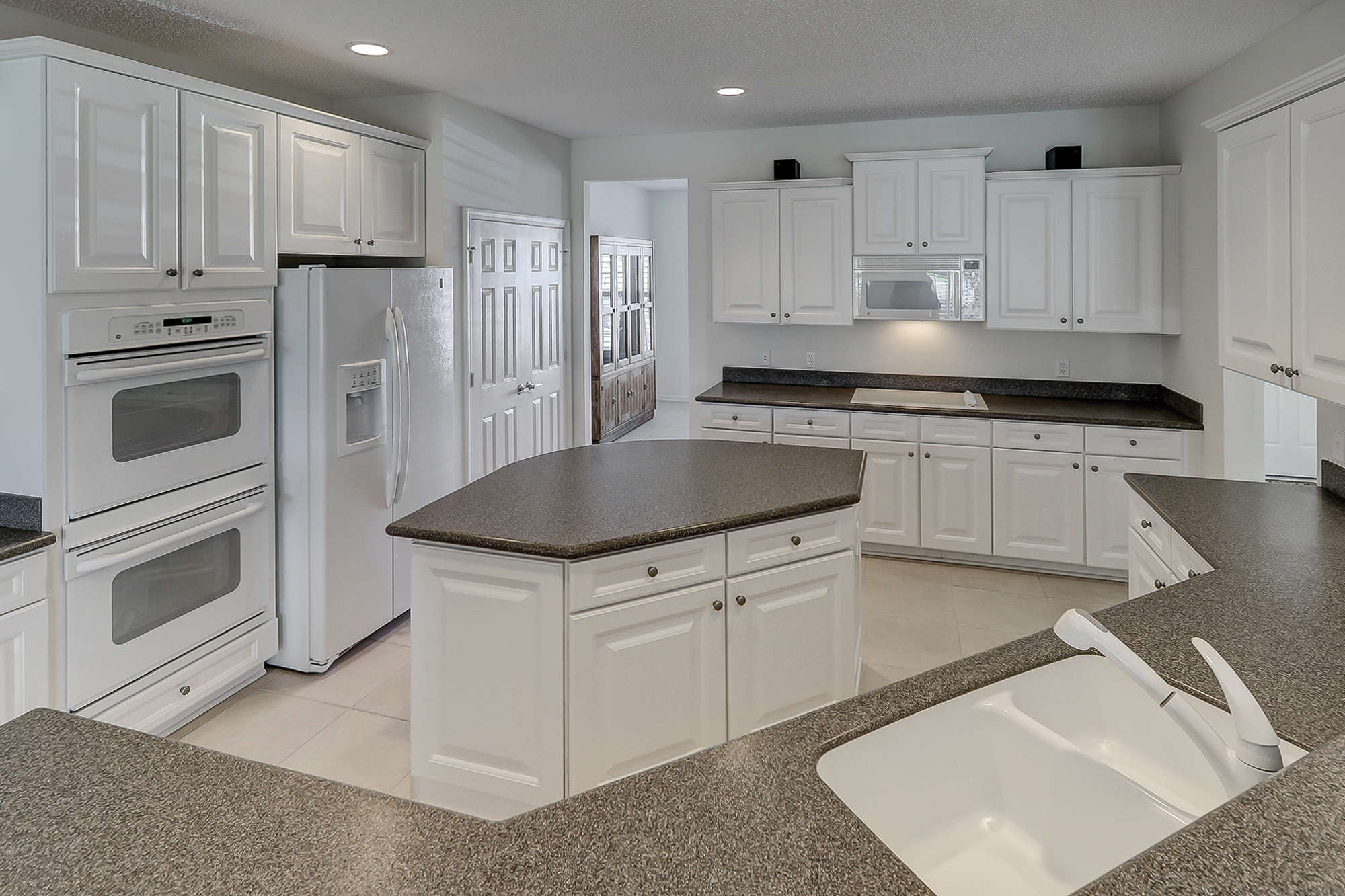 Double Ovens, Roll Outs and Solid Surface Counter Tops are a few of the options in this Sun City Kitchen