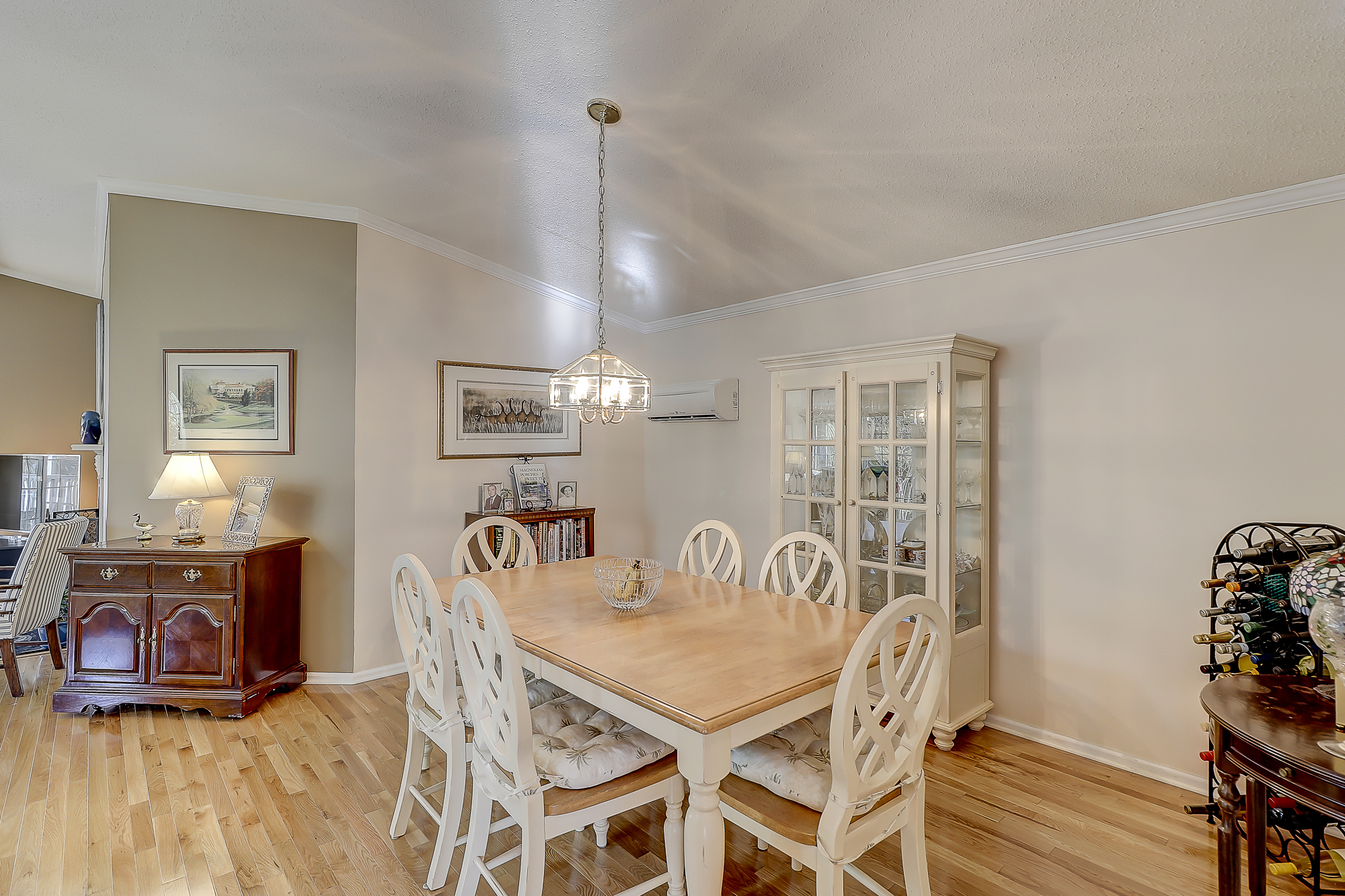 Wood Floors in Great Room, Dining Room and Master Bedroom in this Sawmill Forest Home for Sale